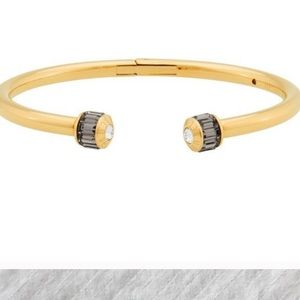 Gold tone Henri Bendel hinge bracelet